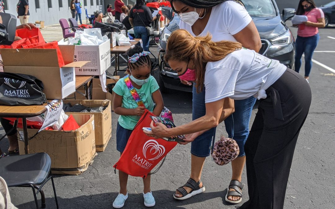 Matrix Human Services Back-To-School Rally Gives 2 Books to Every Child